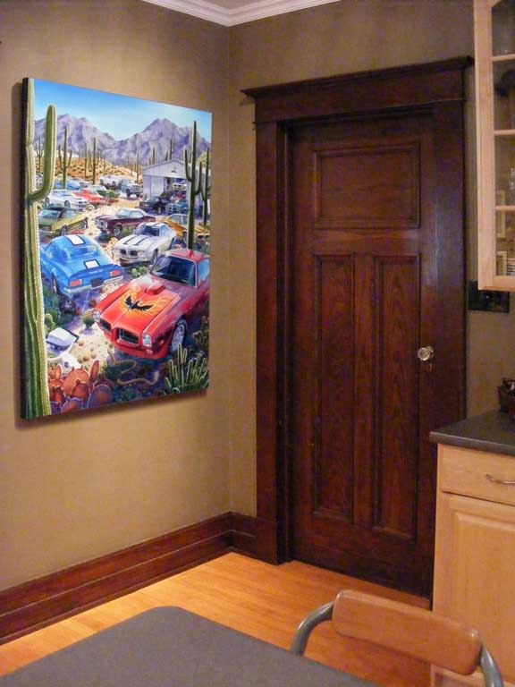 Gallery edition canvas of Michael Irvine's Trans Ams painting hanging in the kitchen.