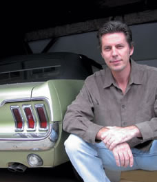 Watercolour Artist Michael Irvine with one of his muscle cars